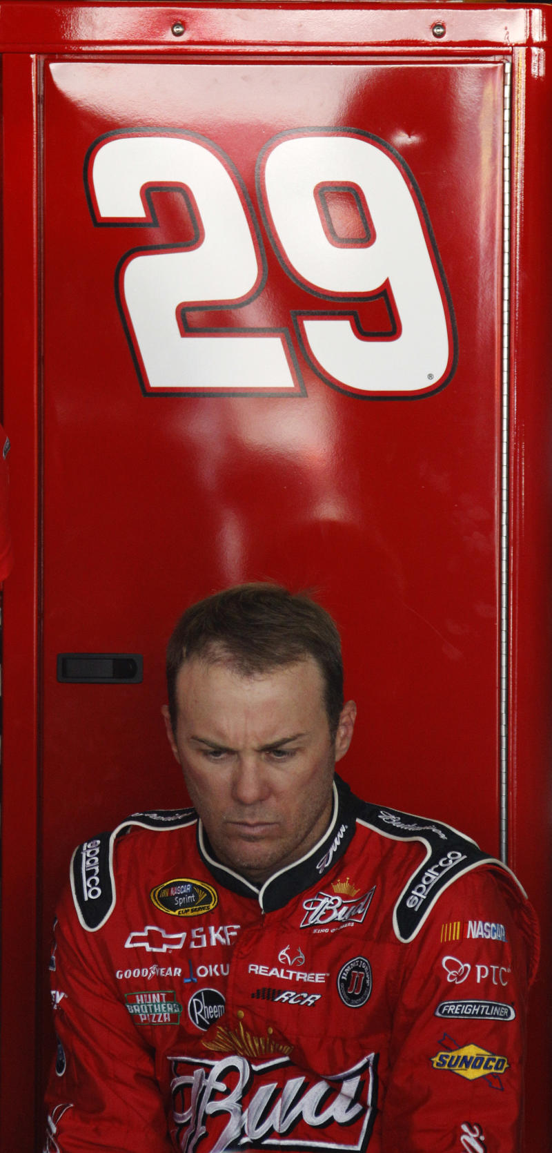 Driver Kevin Harvick waits in the garage as his car is worked on during a practice session for Sunday's NASCAR Sprint Cup series FedEx 400 auto race, Friday, May 13, 2011, in Dover, Del. Harvick and Kyle Busch are on probation and will have to play nice this weekend if they want to avoid further punishment from NASCAR. (AP Photo/Matt Slocum)