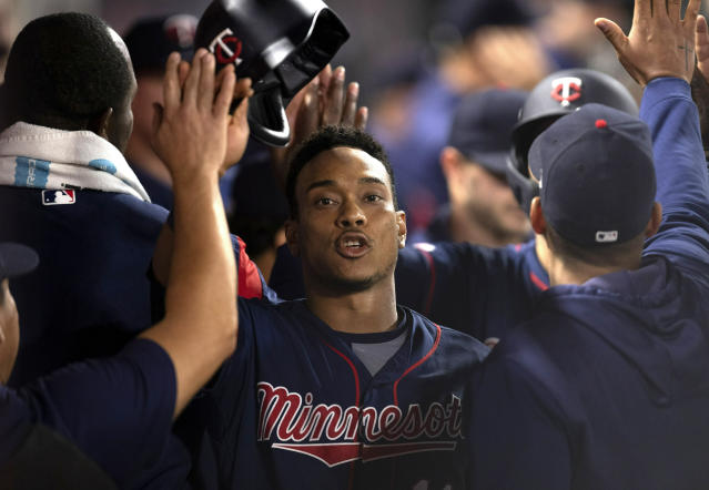 Minnesota Twins' Jorge Polanco is greeted in the dugout after scoring on a two-run single by Eddie Rosario during the seventh inning of the team's baseball game against the Los Angeles Angels in Anaheim, Calif., Tuesday, May 21, 2019. (AP Photo/Kyusung Gong)