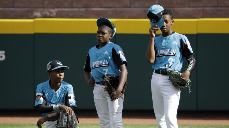 Curacao's Keven Rosina (7) stands in the outfield with Farens Wooter, left, and Nathan Castillo (3) after being taken out of the Little League World Series Championship baseball game pitching against River Ridge, Louisiana, in the fifth inning in South Williamsport, Pa., Sunday, Aug. 25, 2019. (AP Photo/Tom E. Puskar)