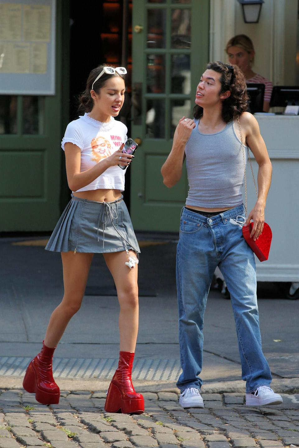 """<h1 class=""""title"""">EXCLUSIVE: Olivia Rodrigo Looks Stylish In NYC As She Steps Out For Lunch With Fellow Hitmaker Conan Gray In Shiny Red Platform Boots.</h1><cite class=""""credit"""">Christopher Peterson / SplashNews.com</cite>"""