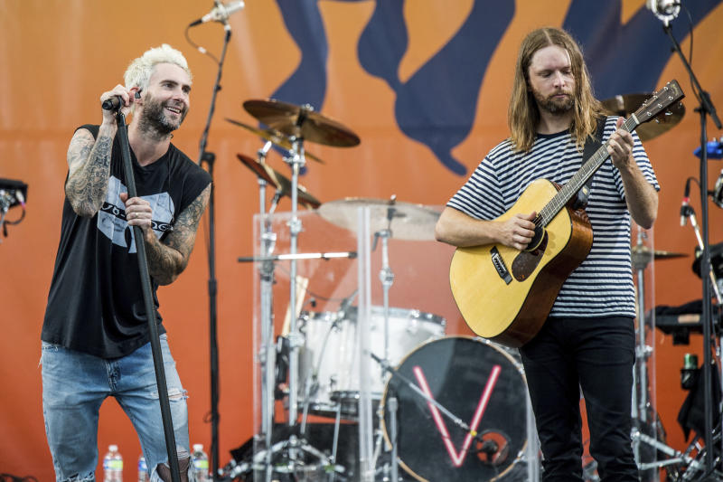 Adam Levine, left, and James Valentine of Maroon 5 perform at the New Orleans Jazz and Heritage Festival on Saturday, April 29, 2017, in New Orleans. (Photo by Amy Harris/Invision/AP)
