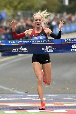 Nov 5, 2017; New York, NY, USA; Shalane Flanagan celebrates as she crosses the finish line to win the professional women's division at the 2017 TCS New York City Marathon. Mandatory Credit: Derik Hamilton-USA TODAY Sports