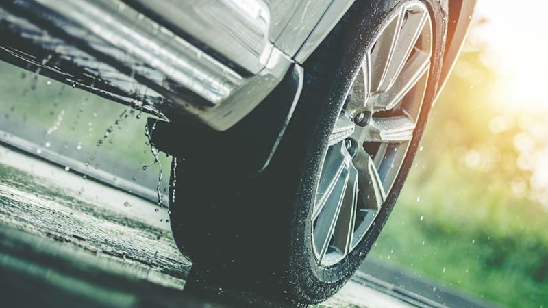 Pictured is a tyre driving through wet conditions.