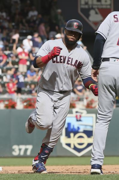 Cleveland Indians' Carlos Santana rounds third base on a grand slam off Minnesota Twins pitcher Taylor Rogers in the 10th inning of a baseball game Sunday, Aug. 11, 2019, in Minneapolis. The Indians won 7-3. (AP Photo/Jim Mone)