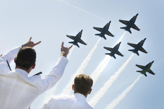 <p>U.S. Naval Academy midshipmen cheer as the U.S. Navy's Blue Angels fly over the graduation ceremony in Annapolis, Md., on May 25, 2018. (Photo: Jim Watson/AFP/Getty Images) </p>