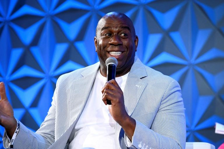 """A ganme-worn Olympic jersey of Magic Johnson, who played on the 1992 US gold medal """"Dream Team"""" at the Barcelona Olympics, is among the items available in a sports memorabilia auction that began Wednesday"""