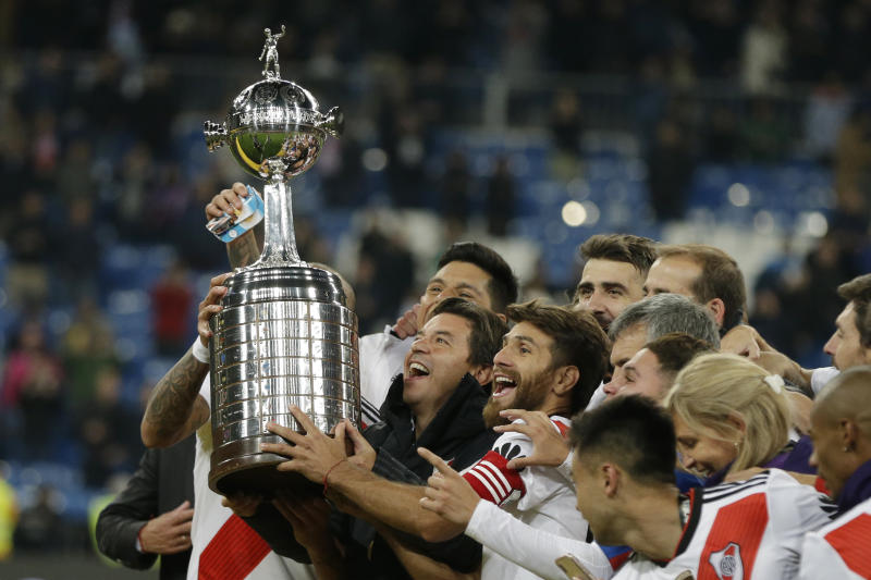 FILE - In this Dec. 9, 2018 file photo, Marcelo Gallardo, coach of Argentina's River Plate, celebrates with the championship trophy after defeating Argentina's Boca Juniors at the Copa Libertadores final soccer match in the Santiago Bernabeu stadium in Madrid, Spain. (AP Photo/Thanassis Stavrakis, File)