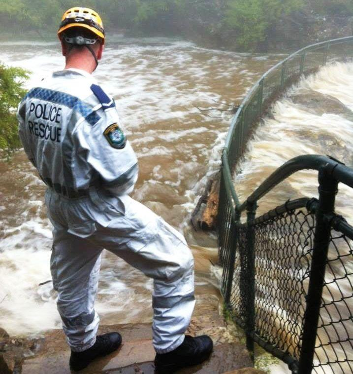 NSW police and SES workers are reportedly frustrated at the amount of people entering flood waters, so far two bodies have been recovered. Photo: Twitter
