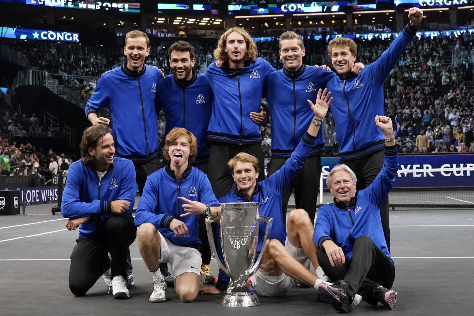 Team Europe celebrates after they defeated Team World for the Laver Cup in tennis, Sunday, Sept. 26, 2021, in Boston. At top from left, are Daniil Medvedev, Mateo Berrettini, Stefanos Tsitsipas, vice captain Thomas Enqvist, and Casper Ruud. At bottom from left, Feliciano Lopez, Andrey Rublev, Alexander Zverev, and captain Bjorn Borg. (AP Photo/Elise Amendola)