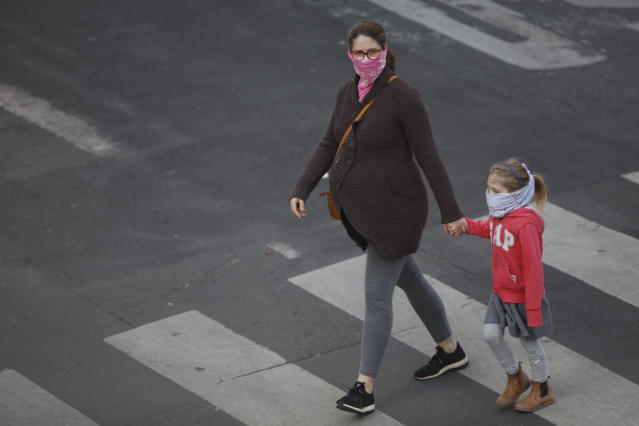 A pregnant woman wears a mask in Paris. (Getty Images)