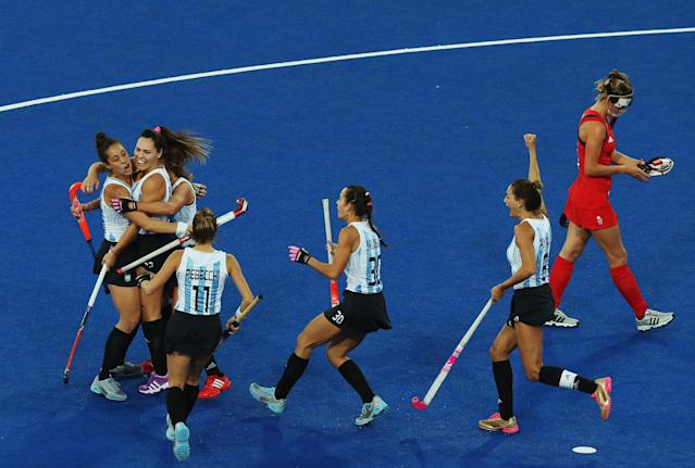 LONDON, ENGLAND - AUGUST 08: Noel Barrionuevo of Argentina celebrates after scoring with team mates during the Women's Hockey semi-final match between Argentina and Great Britain on Day 12 of the London 2012 Olympic Games at Riverbank Arena Hockey Centre on August 8, 2012 in London, England. (Photo by Daniel Berehulak/Getty Images)