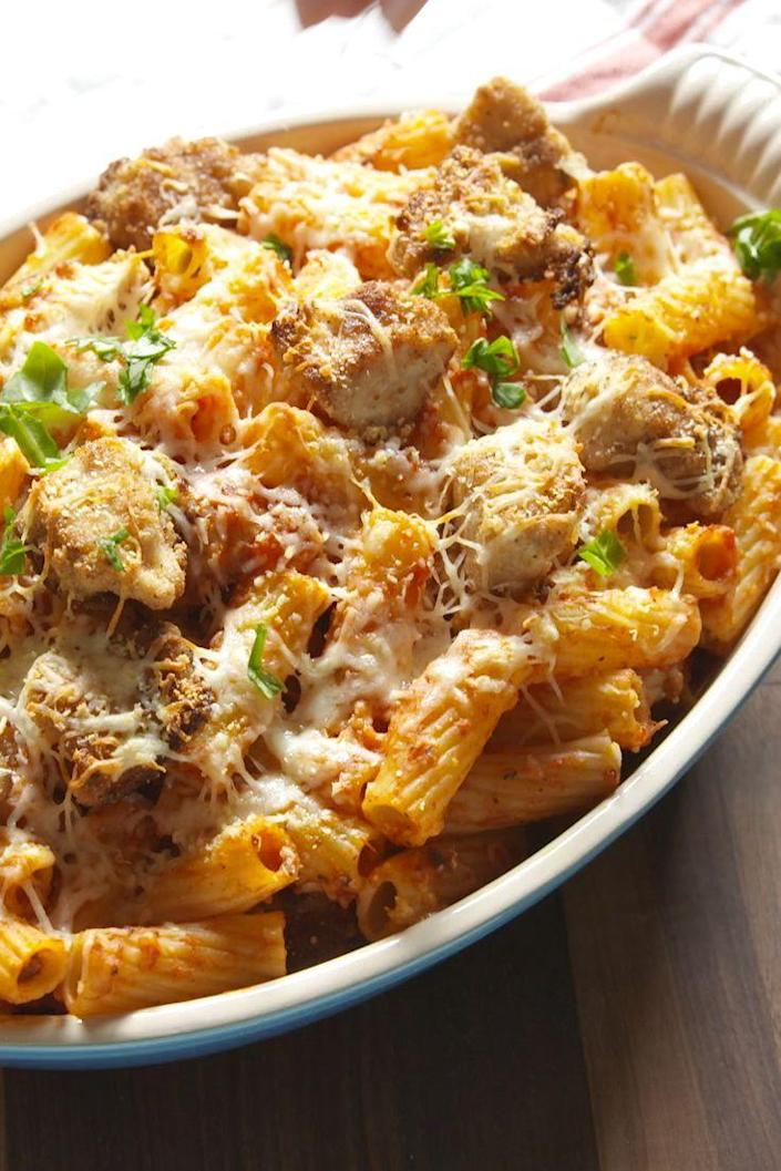 """<p>This casserole ensures every bite has the right mix of chicken, sauce, pasta and cheese.</p><p>Get the recipe from <a href=""""https://www.delish.com/cooking/recipes/a47254/chicken-parm-rigatoni-bake-recipe/"""" rel=""""nofollow noopener"""" target=""""_blank"""" data-ylk=""""slk:Delish"""" class=""""link rapid-noclick-resp"""">Delish</a>.</p>"""