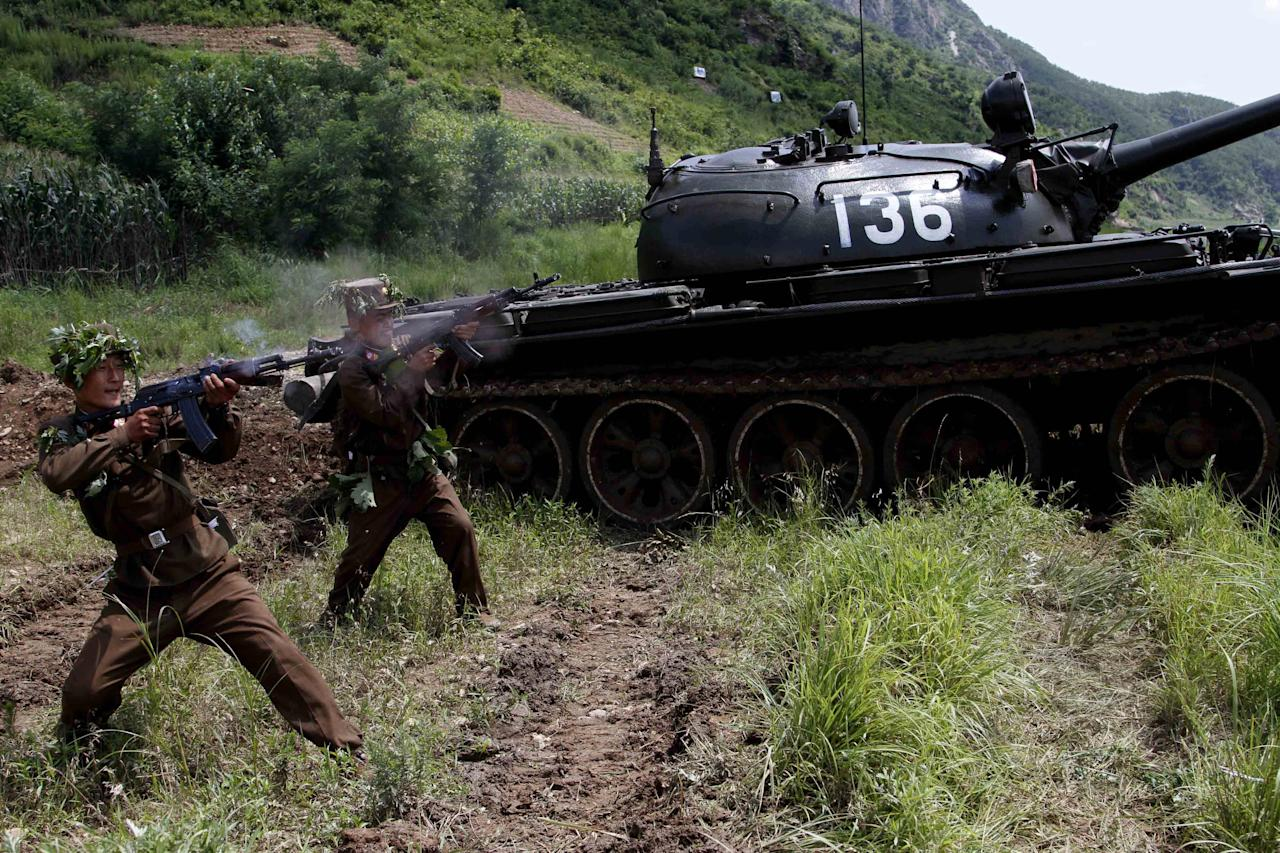 North Korean soldiers from the historic 105 tank unit fire during a military exercise at an undisclosed location in North Korea Friday, July 27, 2012, marking the 59th anniversary of the armistice that ended the 1950-53 Korean War. The 105 tank unit, which denounced joint U.S. and South Korean military exercises, is named after North Korean military officer Ryu Kyong Su, honored by North Korea for his role leading troops during the Korean War. (AP Photo/Jon Chol Jin)