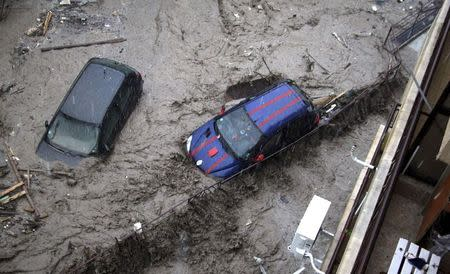 Partially-submerged cars are pictured during heavy flooding in the city of Varna