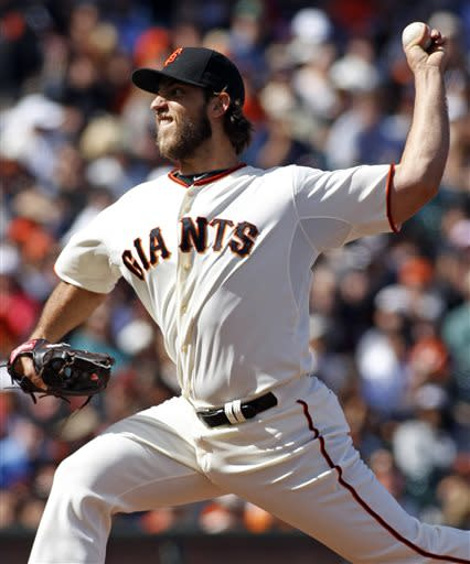 San Francisco Giants pitcher Madison Bumgarner throws to the Los Angeles Dodgers during the first inning of a baseball game in San Francisco, Saturday, July 6, 2013. (AP Photo/George Nikitin)