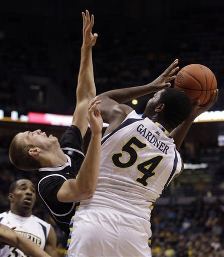 Marquette's Davante Gardner (54) tries to put up a shot in front of Wisconsin Milwaukee's Kyle Kelm during the first half of an NCAA college basketball game on Thursday, Dec. 22, 2011, in Milwaukee. (AP Photo/Morry Gash)