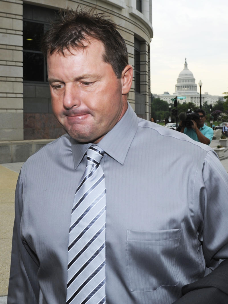 With the Capitol in the background, former Major League Baseball pitcher Roger Clemens arrives at federal court in Washington, Wednesday, July 6, 2011, for his trial on charges of lying to Congress in 2008 when he denied ever using performance-enhancing drugs during his 23-year career.  (AP Photo/Cliff Owen)