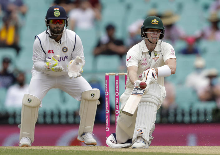 Australia's Steve Smith plays an unorthodox shot while batting during play on day two of the third cricket test between India and Australia at the Sydney Cricket Ground, Sydney, Australia, Friday, Jan. 8, 2021. (AP Photo/Rick Rycroft)
