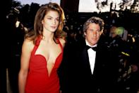 <p>Cindy Crawford looked red hot in her red carpet gown, arriving on the arm of Richard Gere. It's no wonder the pair were PEOPLE's Sexiest Couple Alive in 1993! </p>