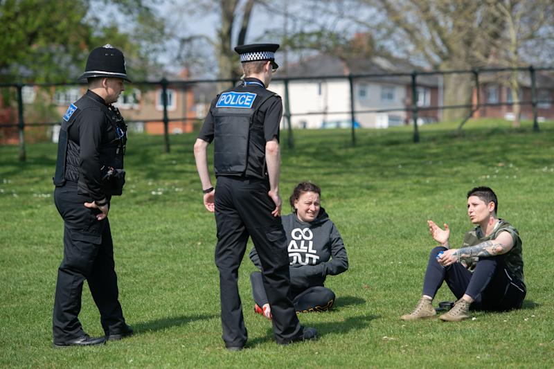 Police officers talk to members of the public at a park in Northampton, as Northants Police announce they are toughening up their social distancing enforcement, as the UK continues in lockdown to help curb the spread of Covid-19.