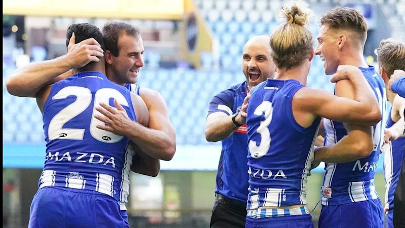 Ben Cunnington (2L) has led North Melbourne to a thrilling two-point AFL opening win over St Kilda