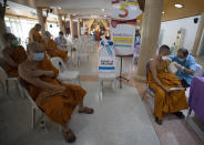 A health worker administers a dose of the AstraZeneca COVID-19 vaccine to a Buddhist monk at Nak Prok Temple in Bangkok, Thailand, Friday, April 9, 2021. (AP Photo/Sakchai Lalit) AstraZeneca