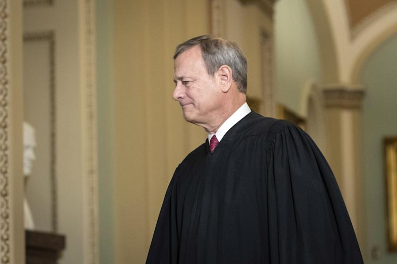 Supreme Court Chief Justice John Roberts arrives at the Senate chamber for impeachment proceedings on Jan. 16, 2020, in Washington.
