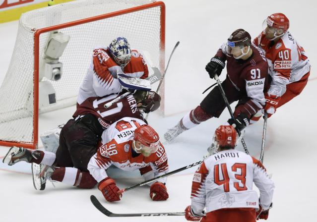 Ice Hockey - 2018 IIHF World Championships - Group B - Latvia v Denmark - Jyske Bank Boxen - Herning, Denmark - May 15, 2018 - Kristaps Sotnieks of Latvia in action with Nicholas Jensen and goaltender Frederik Andersen of Denmark. REUTERS/David W Cerny