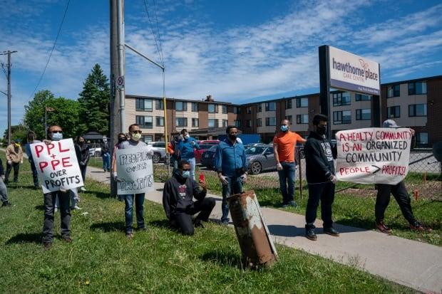 Protesters critical of for-profit care gather outside Hawthorne Place Care Centre in 2020.