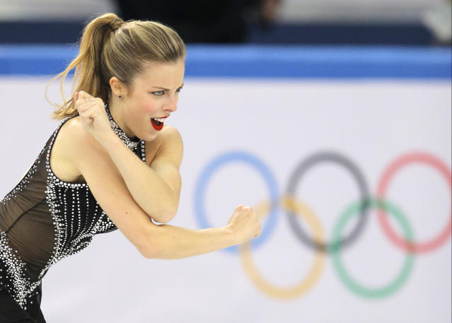 Ashley Wagner of the United States competes in the women's team short program figure skating competition at the Iceberg Skating Palace during the 2014 Winter Olympics, Saturday, Feb. 8, 2014, in Sochi, Russia. (AP Photo/Vadim Ghirda)