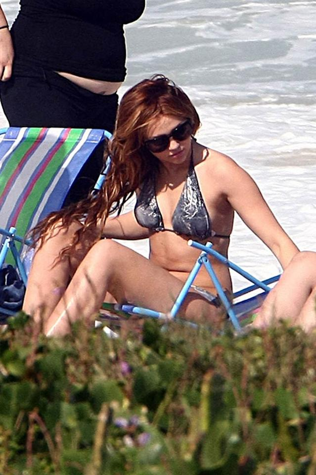 """Miley Cyrus enjoyed a day off by soaking up the sun at Barra da Tijuca, which is the longest beach in Rio de Janeiro, Brazil. The pop star has been busy performing on the South American leg of her Gypsy Heart Tour. <a href=""""http://www.PacificCoastNews.com"""" target=""""new"""">PacificCoastNews.com</a> - May 12, 2011"""
