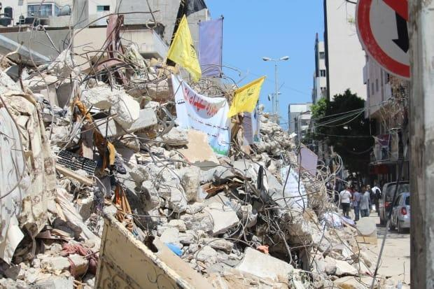 Al-Wehda Street is lined with residential apartments and businesses, some of which are now in ruins.