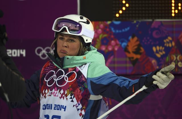 Norway's Wessel reacts after crashes during the women's freestyle skiing moguls qualification round at the 2014 Sochi Winter Olympic Games in Rosa Khutor