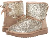 <p>Sparkle-lovers need these <span>UGG Classic Mini Bow Cosmos Boots</span> ($160).</p>