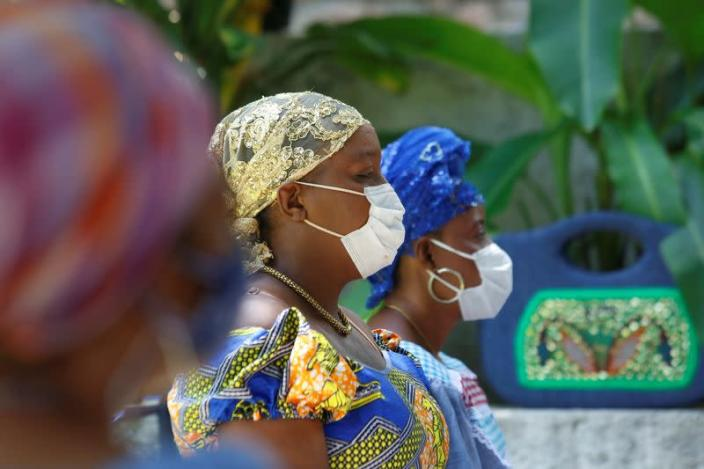 Voodoo priestess, known as Mambo, wear face masks to protect from the spread of the coronavirus disease (COVID-19) as they take part in a ceremony in Port-au-Prince