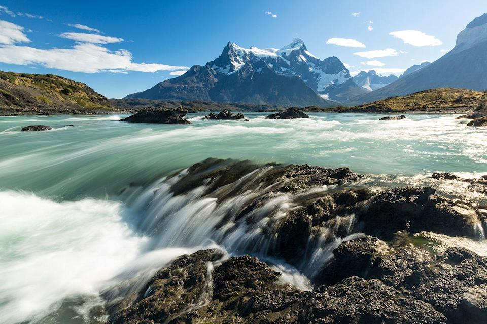 "<p>Whitewater rapids on the Rio Paine plunge below <a href=""https://www.tripadvisor.com/Attraction_Review-g670171-d318185-Reviews-Nordenskjold_Lake-Torres_del_Paine_National_Park_Magallanes_Region.html"" rel=""nofollow noopener"" target=""_blank"" data-ylk=""slk:Lake Nordenskjold"" class=""link rapid-noclick-resp"">Lake Nordenskjold</a>, a body of water located in Torres de Paine National Park in Patagonia, Chile. A very slow camera shutter speed of 0.3 seconds makes the water look as if it has been painted. </p>"