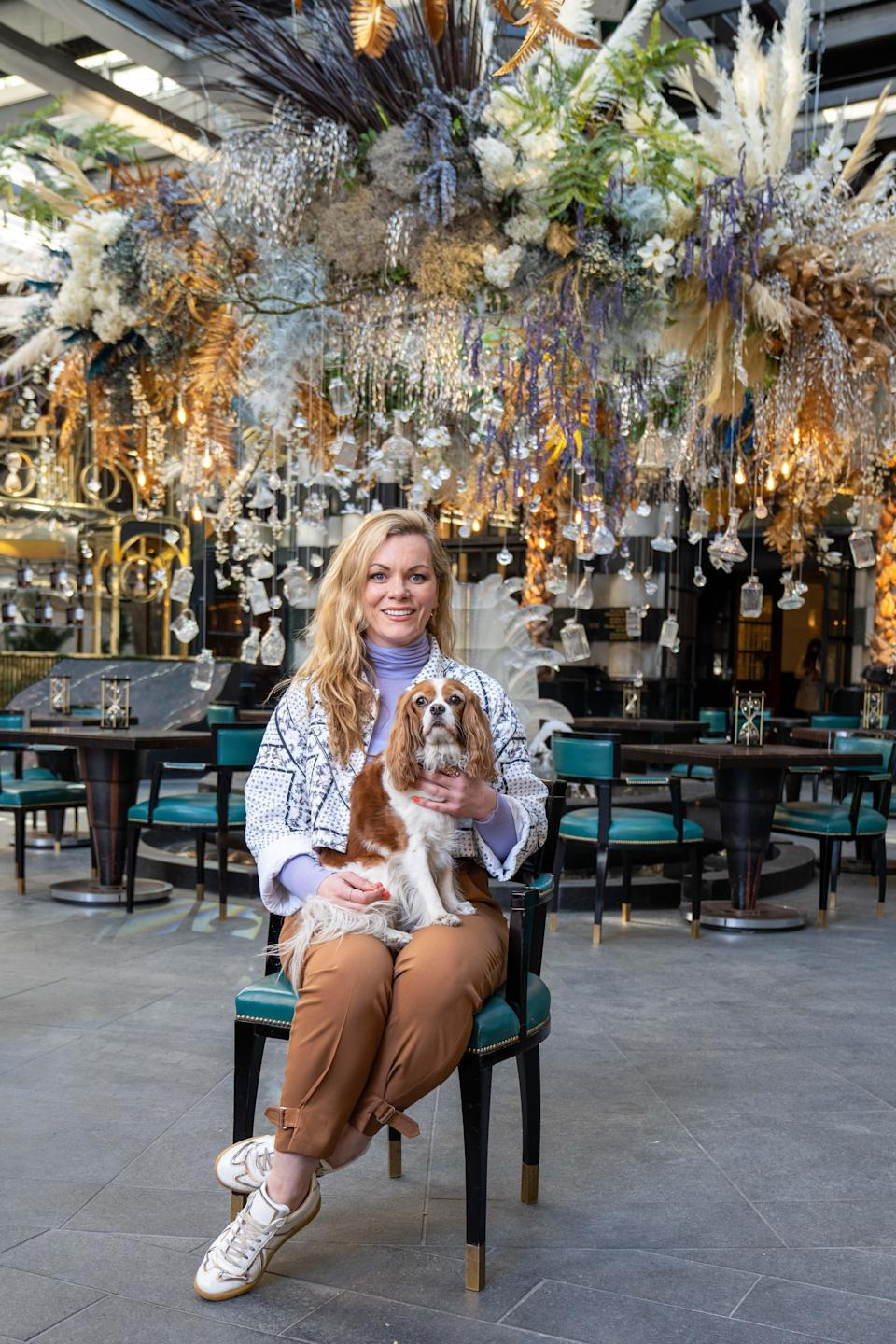Creator Meredith O'Shaughnessy and her dog Phoebe on the terraceCasey Gutteridge