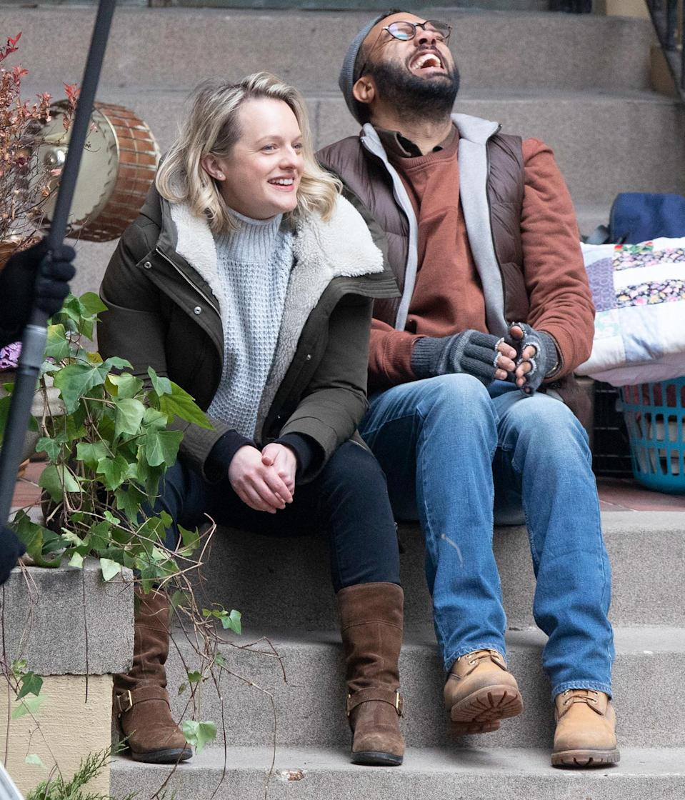 <p>Elisabeth Moss and costar O.T. Fagbenle film scenes for season 4 of <em>The Handmaid's Tale</em> in Hamilton, Ontario, Canada, on Monday.</p>