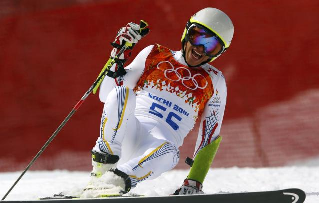 Andorra's Joan Verdu Sanchez laughs after crashing during the first run of the men's alpine skiing giant slalom event at the 2014 Sochi Winter Olympics at the Rosa Khutor Alpine Center February 19, 2014. REUTERS/Ruben Sprich (RUSSIA - Tags: SPORT SKIING OLYMPICS)