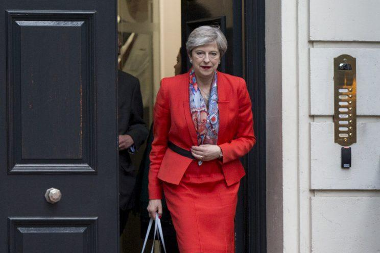 <i>Theresa May was seen in the same suit she wore to meet Donald Trump [Photo: PA]</i>