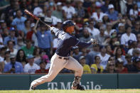 Tampa Bay Rays' Wander Franco follows through on a single against the Boston Red Sox during the third inning of a baseball game Monday, Sept. 6, 2021, at Fenway Park in Boston. (AP Photo/Winslow Townson)
