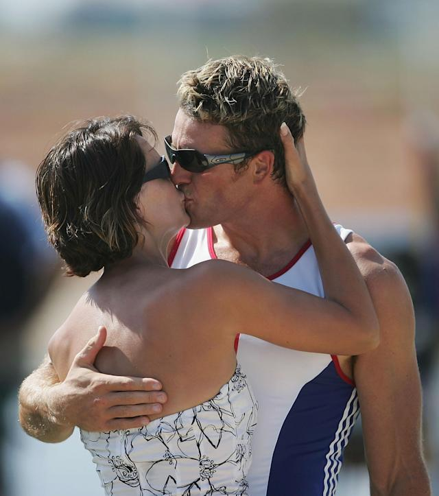 ATHENS - AUGUST 21: James Cracknell of Great Britain kisses his wife Beverly Turner after receiving his Gold medal for the men's four rowing event on August 21, 2004 during the Athens 2004 Summer Olympic Games at the Schinias Olympic Rowing and Canoeing Centre in Athens, Greece. (Photo by Shaun Botterill/Getty Images)
