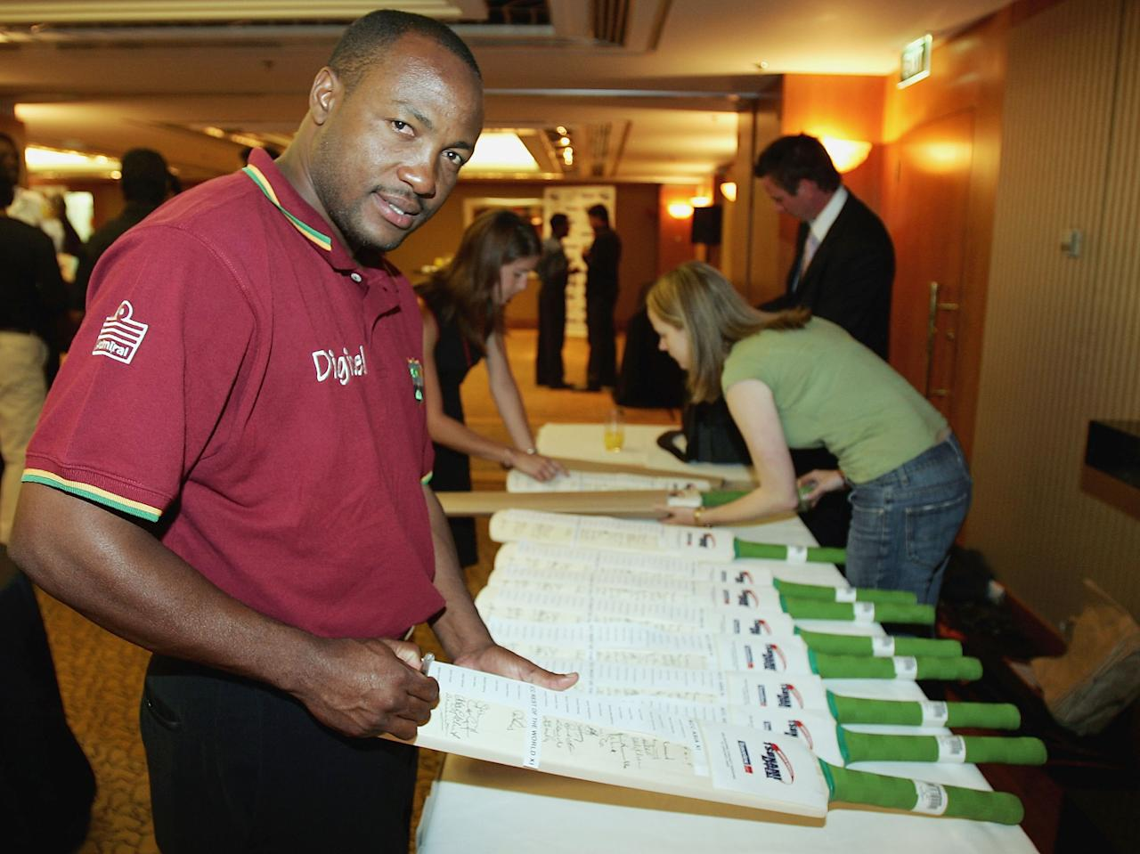 MELBOURNE, AUSTRALIA - JANUARY 9:  Brian Lara signs his autograph during a reception for tomorrows Tsunami Appeal Cricket match at the Hyatt On Collins on January 9, 2005 in Melbourne, Australia. (Photo by Mark Dadswell/Getty Images)