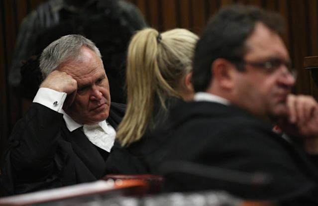Barry Roux (L) , defence lawyer for Paralympic gold medalist Oscar Pistorius gestures during the third day of his clients resentencing hearing for the 2013 murder of his girlfriend Reeva Steenkamp, at Pretoria High Court, South Africa June 15, 2016. REUTERS/Siphiwe Sibeko
