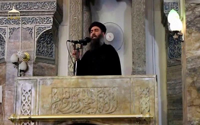Abu Bakr al-Baghdadi making what would have been his first public appearance in Mosul - Credit: AP
