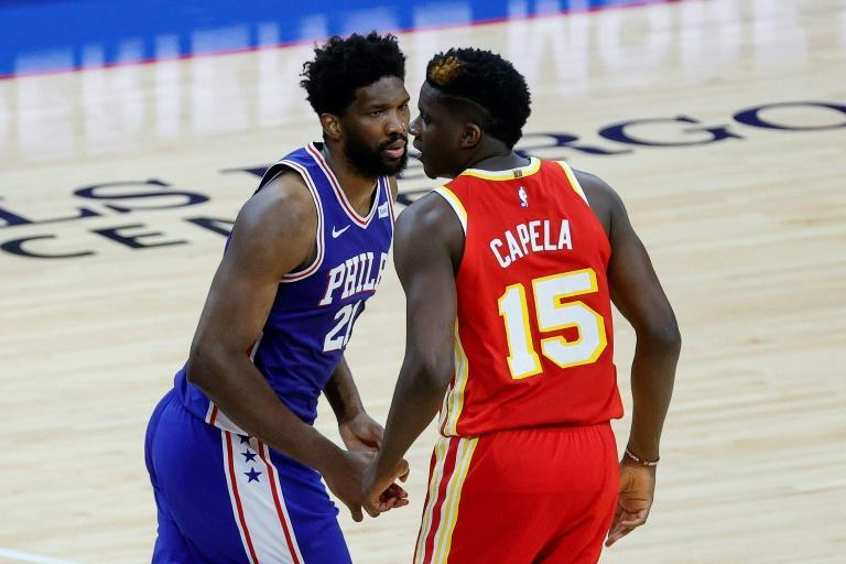 Joel Embiid of the Philadelphia 76ers looks at Clint Capela of the Atlanta Hawks during the second quarter during Game Two of the Eastern Conference second round series at Wells Fargo Center on June 08, 2021 in Philadelphia, Pennsylvania