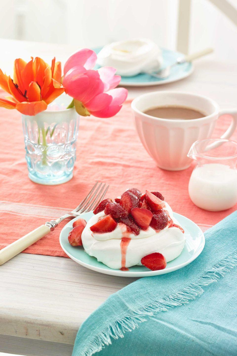 """<p>These elegant meringue treats will satisfy every sweet tooth. </p><p><em><a href=""""https://www.womansday.com/food-recipes/food-drinks/recipes/a54431/pavlovas-with-strawberries-and-cream-recipe/"""" rel=""""nofollow noopener"""" target=""""_blank"""" data-ylk=""""slk:Get the recipe for Pavlovas with Strawberries and Cream."""" class=""""link rapid-noclick-resp"""">Get the recipe for Pavlovas with Strawberries and Cream.</a></em></p>"""