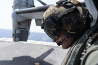 """U.S. Marie Corps Cpl. Jacob Simons watches as his VM-22 Osprey lands on the USS Arlington for refueling Saturday, Aug. 28, 2021, in the Caribbean Sea near Haiti. The VMM-266, """"Fighting Griffins,"""" from Marine Corps Air Station New River, from Jacksonville, N.C., are flying in support of Joint Task Force Haiti after a 7.2 magnitude earthquake on Aug. 22, caused heavy damage to the country. (AP Photo/Alex Brandon)"""