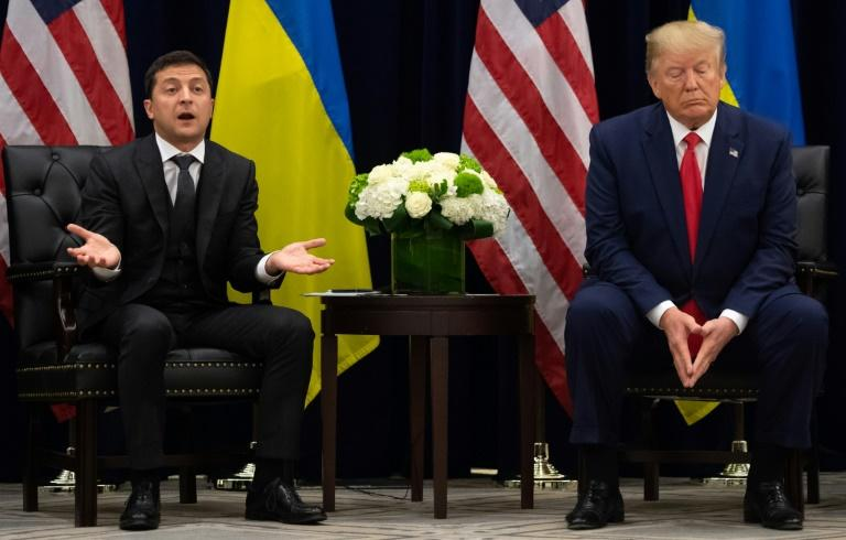 Quid pro quo? US President Donald Trump and Ukrainian President Volodymyr Zelensky speak to the press during a meeting at the UN in New York on September 25 (AFP Photo/SAUL LOEB)