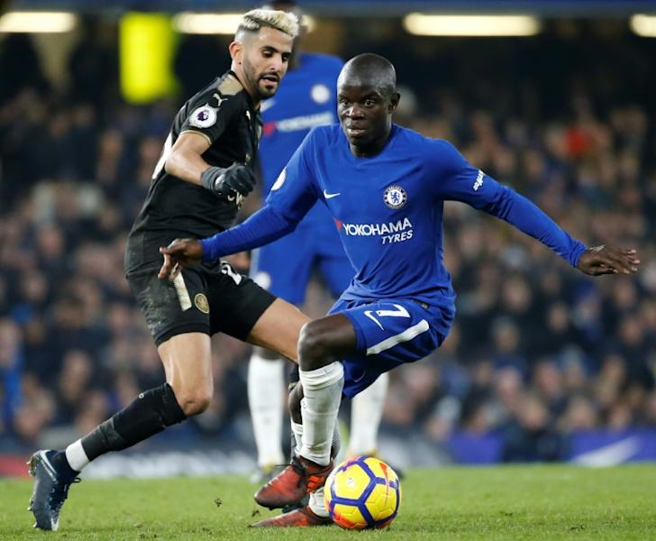 Chelsea's N'Golo Kante (R) turns away from Leicester City midfielder Riyad Mahrez (L) during their Premier League match at London's Stamford Bridge